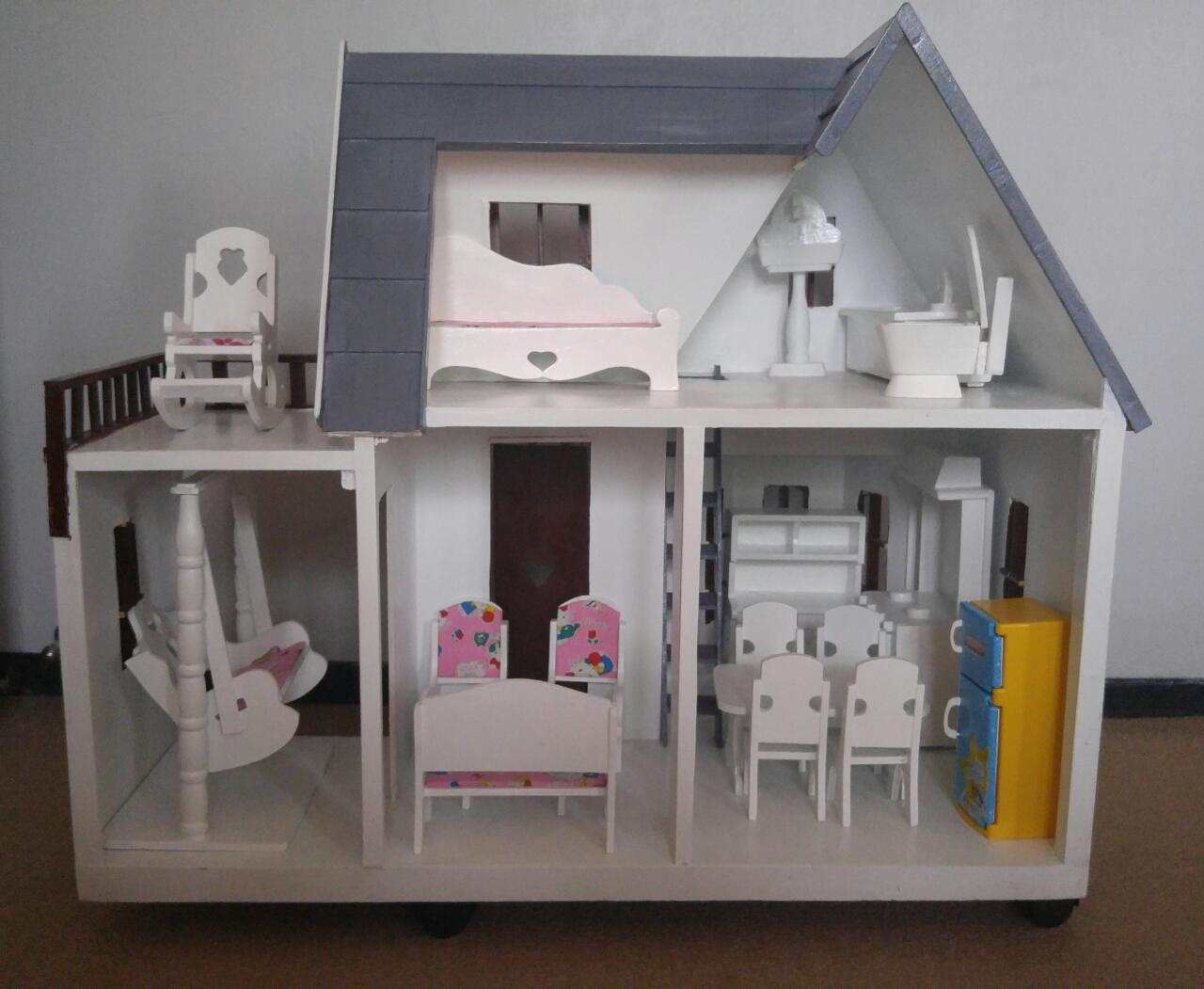 Doll house with furniture | Spotsewa
